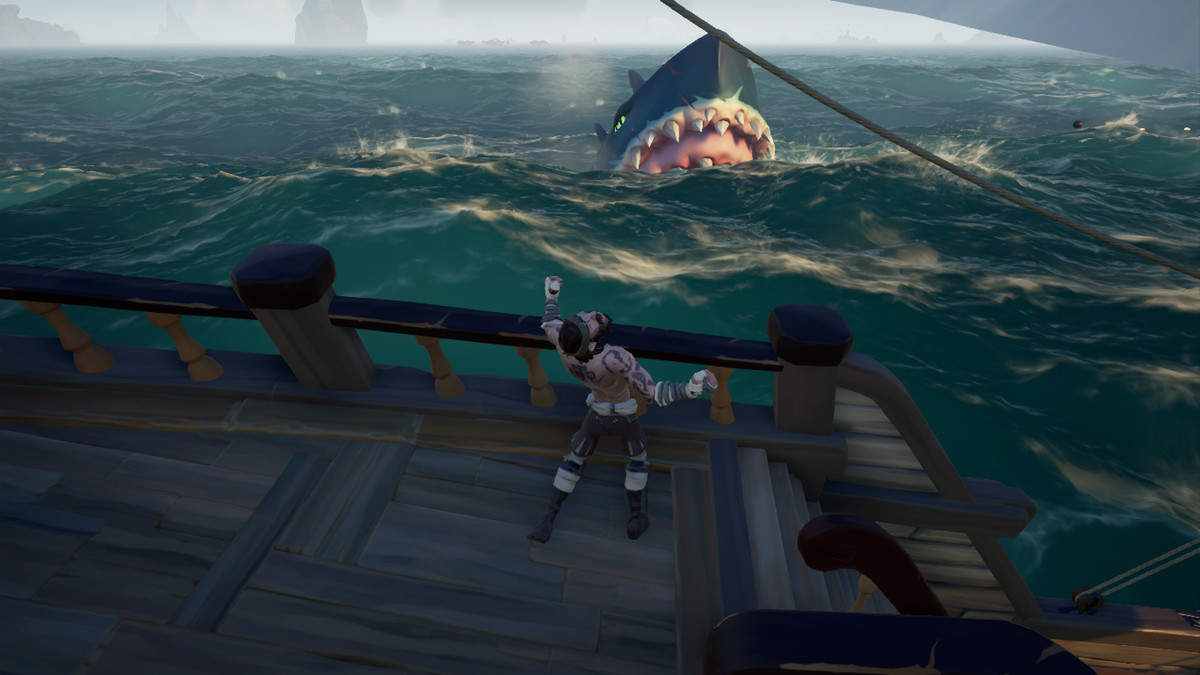 An angry megalodon charges a pirate