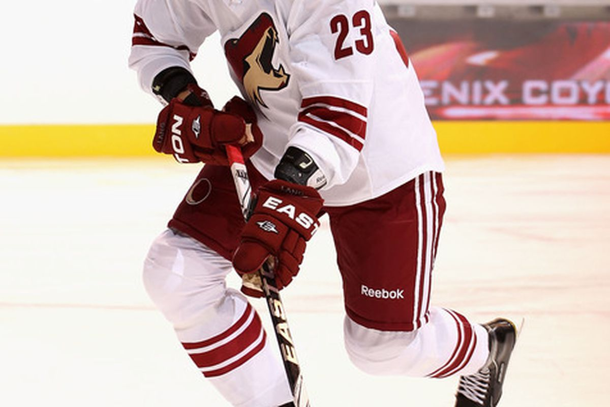 GLENDALE AZ -Oliver Ekman-Larsson #23 of the Phoenix Coyotes skates with the puck during the first period fo the NHL Rookie game against the Los Angeles Kings at Jobing.com Arena in Glendale Arizona.  (Photo by Christian Petersen/Getty Images)