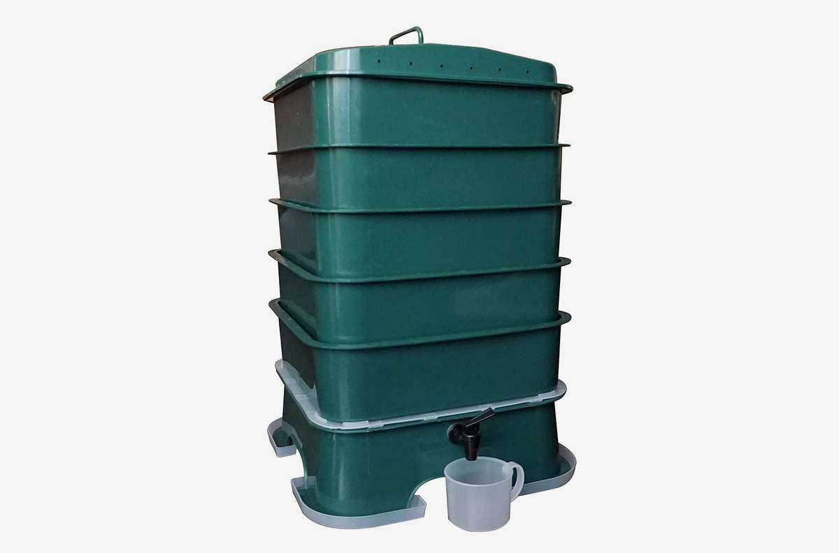 Dark green container shaped like a column with horizontal ridges.