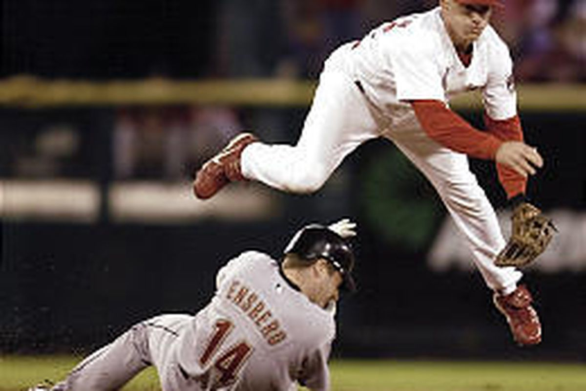 St. Louis shortstop David Eckstein leaps and delivers a throw over a sliding Morgan Ensberg Wednesday.