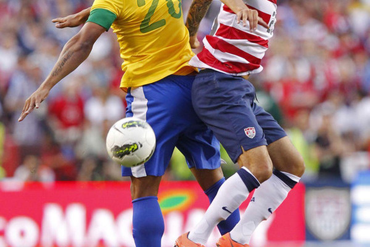 May 30, 2012; Landover, MD, USA; USA midfielder Fabian Johnson (23) and Brazil forward Hulk (20) battle for the ball in the first half at FedEx Field. Brazil won 4-1. Mandatory Credit: Geoff Burke-US PRESSWIRE