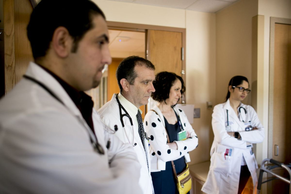 Elizabeth Moje, the dean of the school of education at the University of Michigan joins a resident, an intern and a medical student as they meet with a patient at Beaumont Hospital – Dearborn. A school she's developing will similarly create ways for teachers to learn from peers a year or two ahead of them.