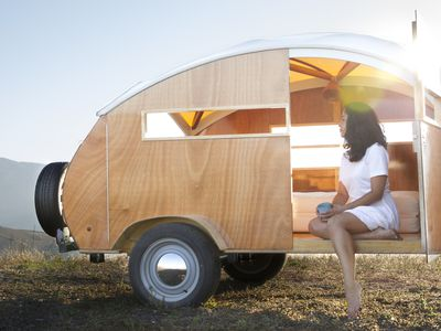 Wooden teardrop trailer is like a tiny land yacht for camping