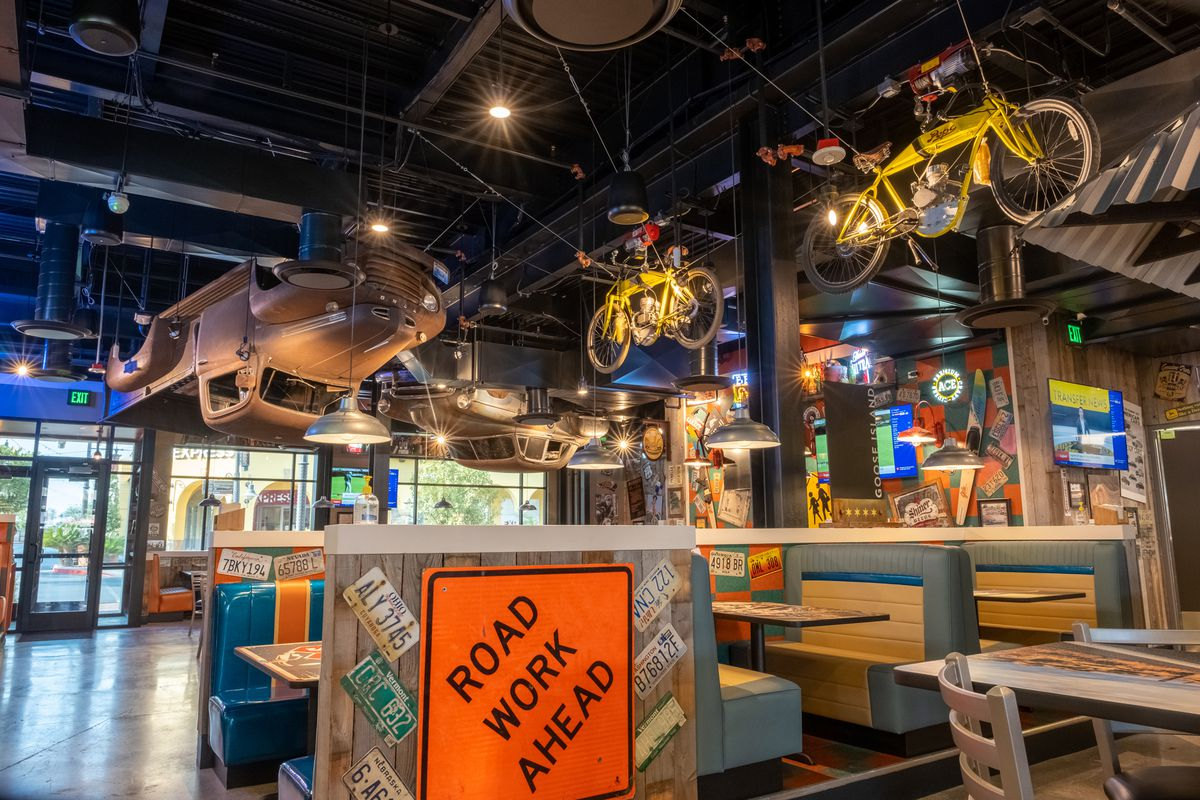 A truck and bicycles hang from the ceiling of a restaurant