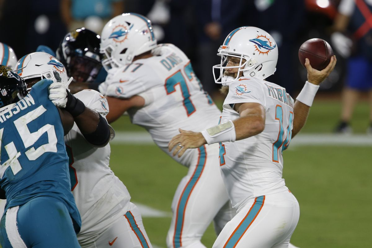 Dolphins quarterback Ryan Fitzpatrick (14) throws a touchdown pass against Jacksonville Jaguars defensive end K'Lavon Chaisson (45) during the first quarter at TIAA Bank Field.