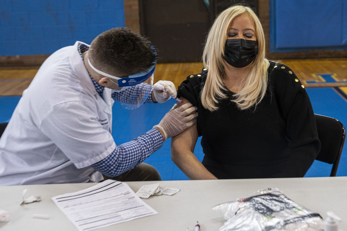 Katrina Haynes from Clinton Elementary receives the Moderna vaccine at a CPS vaccination site at Roberto Clemente Community Academy at 1147 N Western Ave in Ukrainian Village, Thursday, Feb. 11, 2021.
