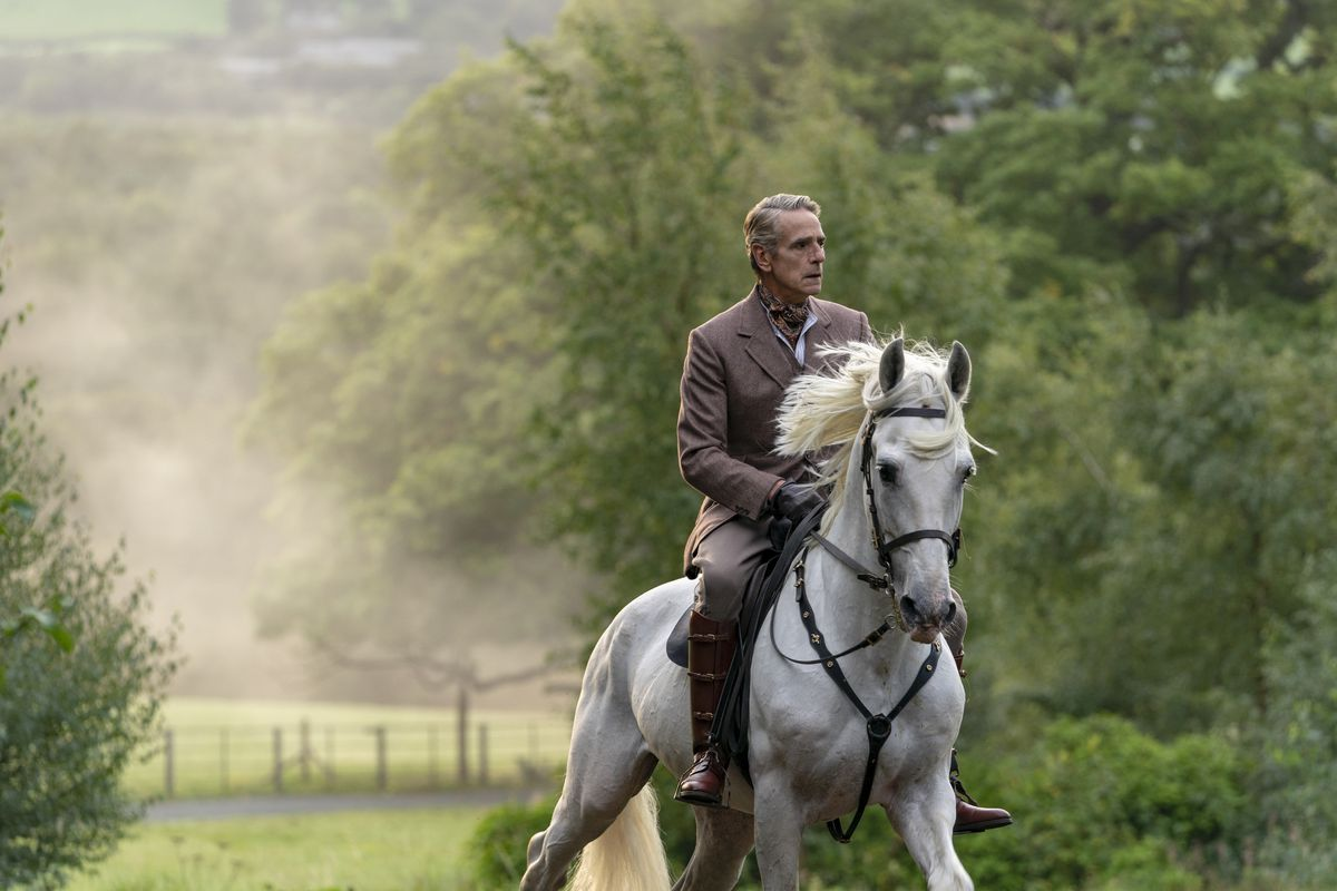 Jeremy Irons rides a horse, innocuously.