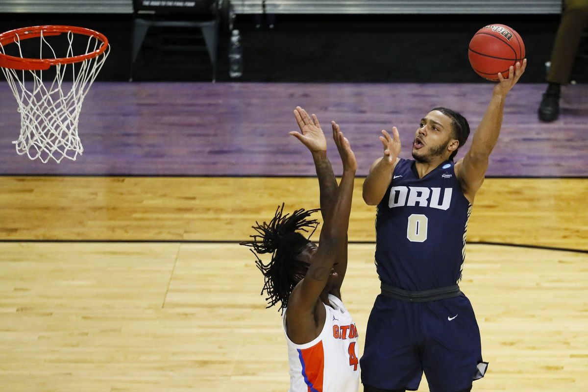 Oral Roberts Golden Eagles forward Kevin Obanor takes a shot over Florida Gators forward Anthony Duruji in the first half during the second round of the 2021 NCAA Tournament on Sunday, March 21, 2021, at Indiana Farmers Coliseum in Indianapolis, Ind.