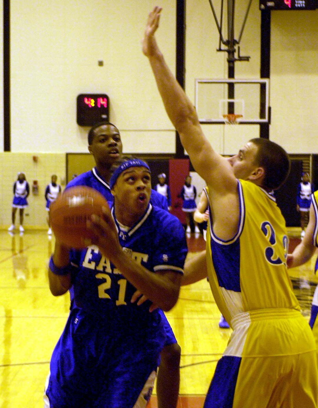 Proviso East's Shannon Brown tries to find his way around Lyon's Steve Groetsema.