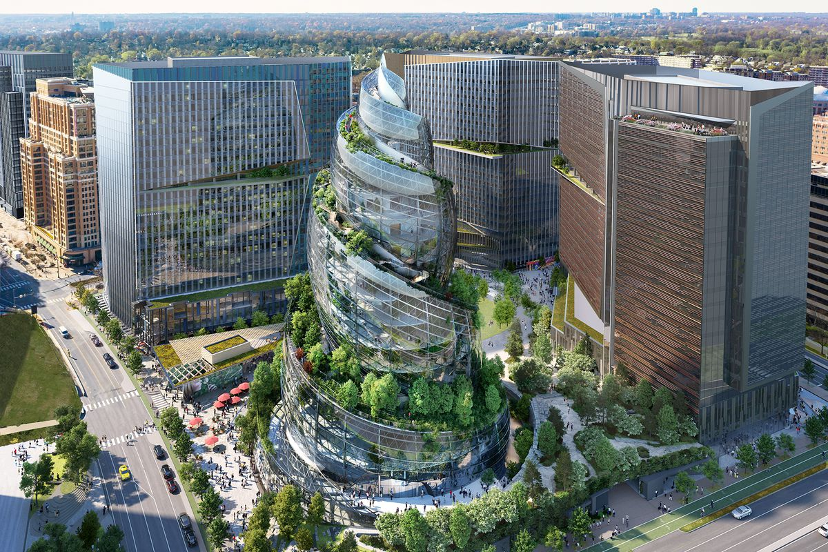 Amazon unveiled the next headquarters design - a glass poop emoji covered in trees