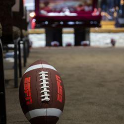 A football is placed in the center aisle during a funeral service for Aaron Lowe at Family Cathedral of Praise on Monday, Oct. 11, 2021, in Mesquite, Texas. Lowe, a student and football player at the University of Utah, was was shot and killed on Sept. 26 at a postgame party.