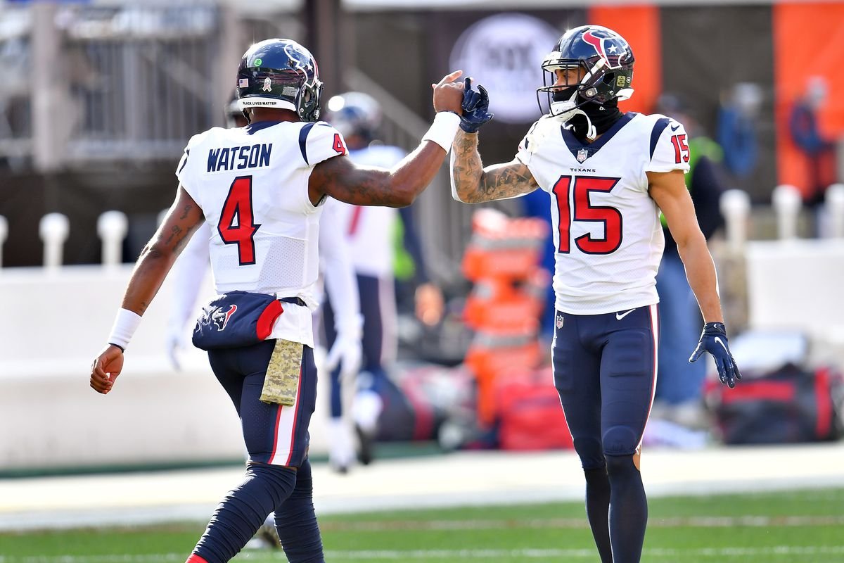 Deshaun Watson #4 and Will Fuller V #15 of the Houston Texans warm up prior to the game against the Cleveland Browns at FirstEnergy Stadium on November 15, 2020 in Cleveland, Ohio.