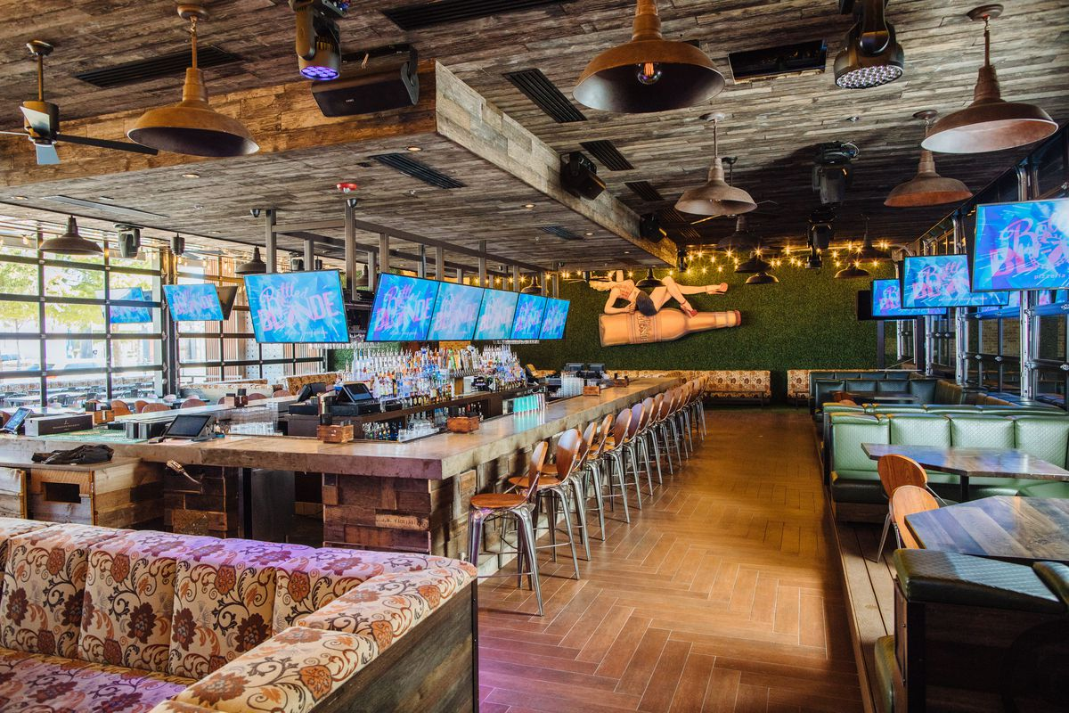 Amid This Cacophony Of Styles Over A Dozen Flat Screen Tvs Are Suspended From The Ceiling Around Bar Booths And On Accent Walls