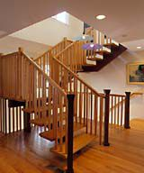 <p>Windows in the stairwell bring light into the center of the house. The stairway itself is the centerpiece of the remodeled first floor. It consists of wood treads that are supported by a red steel stringers.</p>
