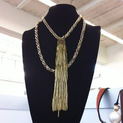 This Gabriela Artigas necklace features a gold tassel from the 1900's!