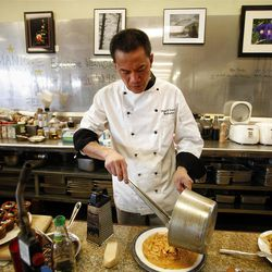 Hai Fitzgerald prepares food at Thyme and Seasons Restaurant in Bountiful on Monday, April 9, 2012.