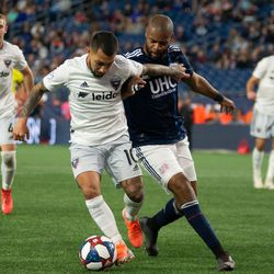 FOXBOROUGH, MA - MAY 25: D.C. United midfielder Luciano Acosta #10 battles with New England Revolution defender Andrew Farrell #2 during the second half at Gillette Stadium on May 25, 2019 in Foxborough, Massachusetts. (Photo by J. Alexander Dolan - The Bent Musket)