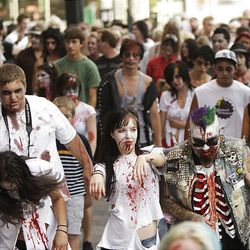 Participants dressed in zombie attire take part in the third annual Zombie Walk in downtown Salt Lake City Sunday. Participants made their way around downtown in a somewhat orderly fashion, with many limping along the way.