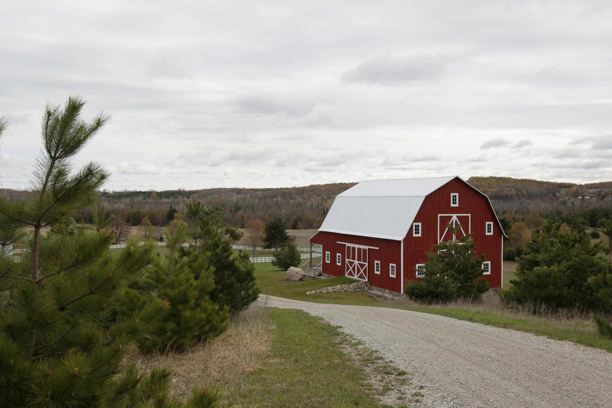 A restored barn owned by Robert Garvey stands Tuesday, April 10, 2012 in Acme Township, Mich.