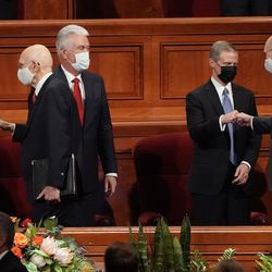 General authorities of The Church of Jesus Christ of Latter-day Saints greet each other during the afternoon session of the 191st Semiannual General Conference at the Conference Center in Salt Lake City on Saturday, Oct. 2, 2021.