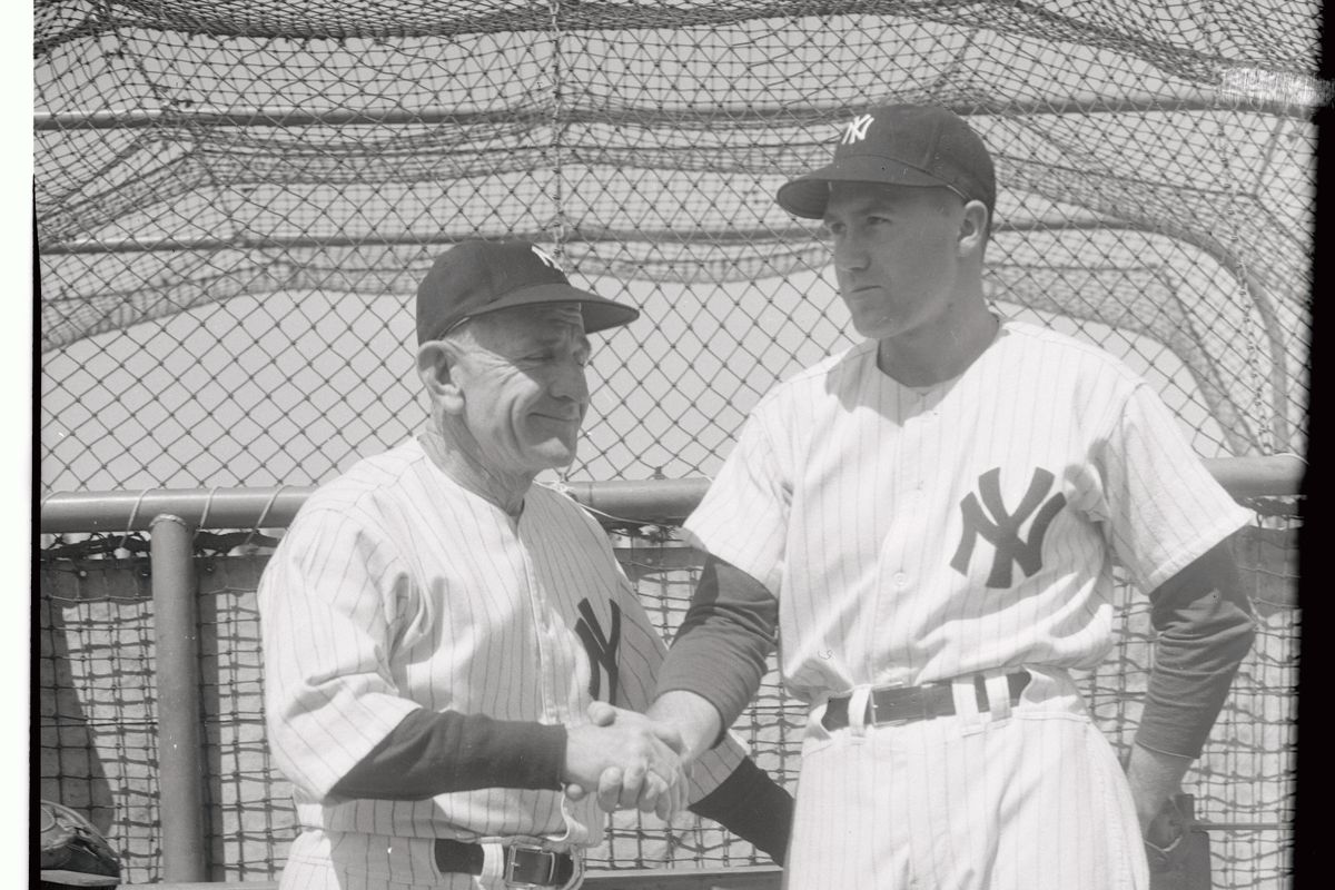 Casey Stengel Shaking Hands with Bobby Brown.