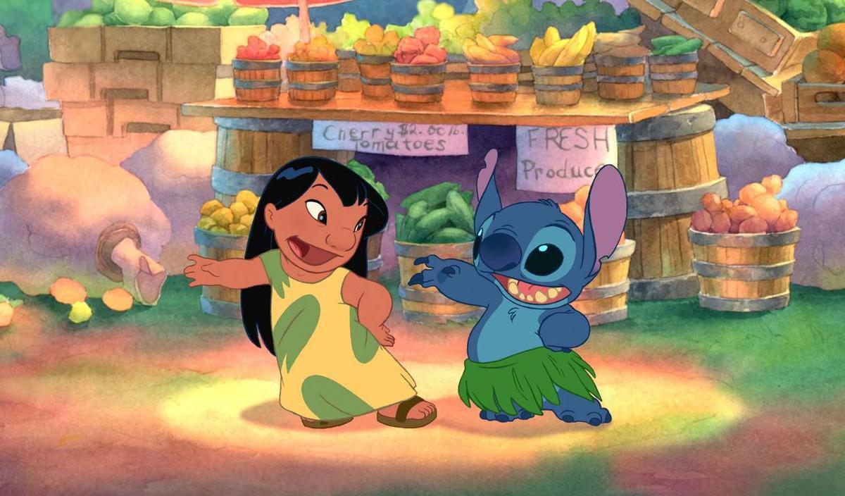 """Lilo, left, teaches Stitch to hula in the Disney animated comedy """"Lilo & Stitch."""""""