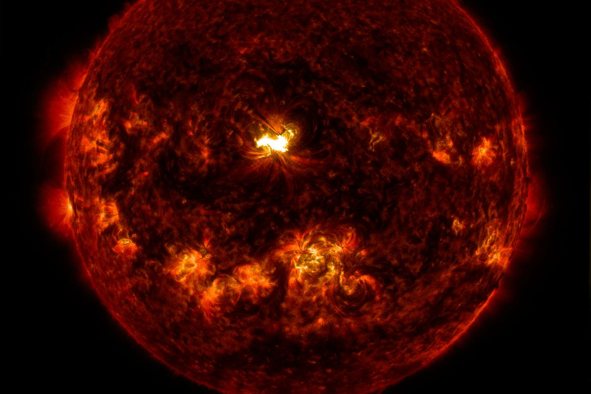 An X1.6 class solar flare flashes in the middle of the sun on Sept. 10, 2014. This image was captured by NASA's Solar Dynamics Observatory and shows a blend of light from the 171 and 304 Angstrom wavelengths.