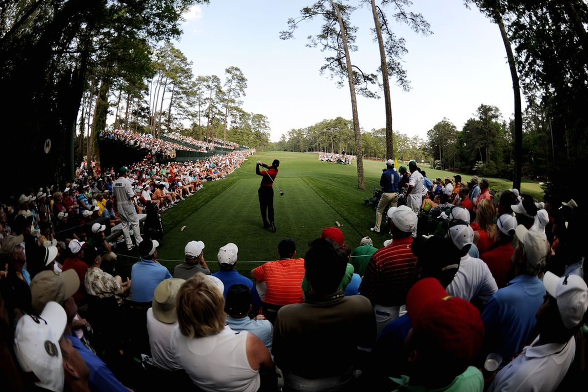 AUGUSTA, GA - APRIL 10:  Tiger Woods hits his tee shot on the 14th hole during the final round of the 2011 Masters Tournament at Augusta National Golf Club on April 10, 2011 in Augusta, Georgia.  (Photo by Harry How/Getty Images)
