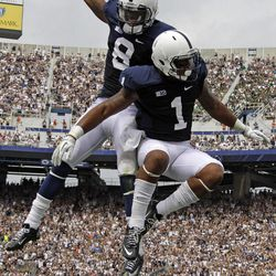 Penn State running back Bill Belton (1) celebrates with teammate wide receiver Allen Robinson (8) after rushing for the first touchdown of the new season during the first quarter of an NCAA college football game against Ohio at Beaver Stadium in State College, Pa., Saturday, Sept. 1, 2012.