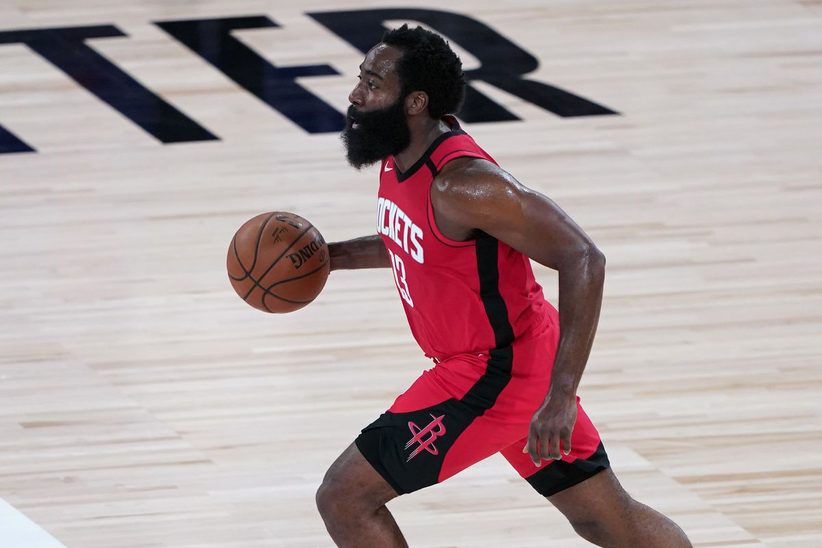James Harden of the Houston Rockets dribbles up the court against the Philadelphia 76ers during the first half of an NBA basketball game at the ESPN Wide World Of Sports Complex on August 14, 2020 in Lake Buena Vista, Florida.