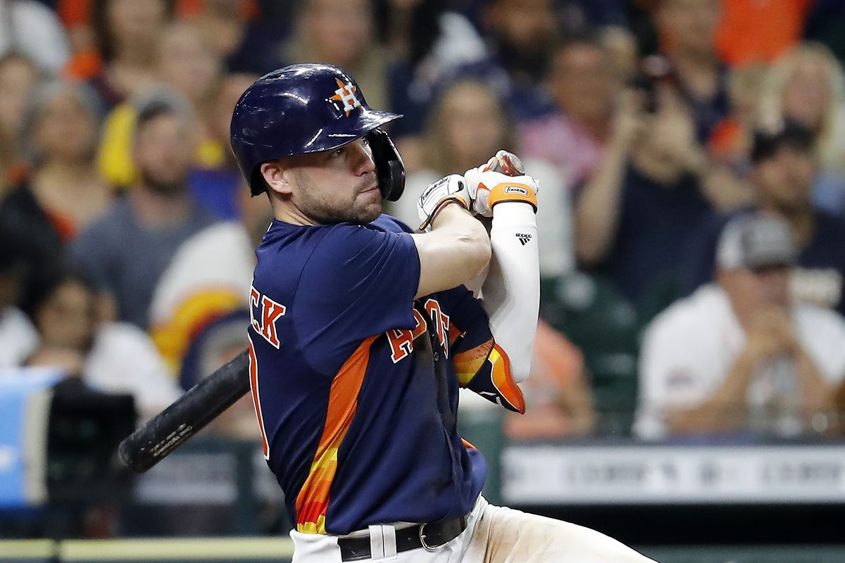 Chas McCormick #20 of the Houston Astros singles in two runs in the eighth inning against the Texas Rangers at Minute Maid Park on May 16, 2021 in Houston, Texas.