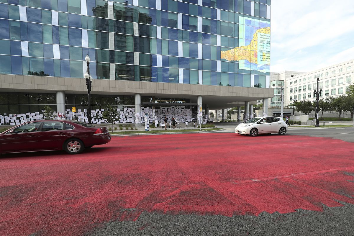 Family and friends of Bernardo Palacios-Carbajal painted the street red in protest in front of the Salt Lake County District Attorney's Office in Salt Lake City.