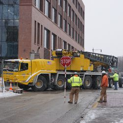 Construction crane successfully backing out of the work site