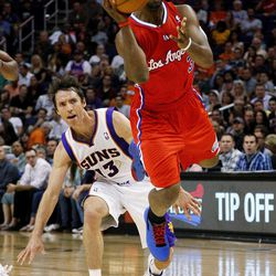 Los Angeles Clippers' Chris Paul, right, shoots past Phoenix Suns' Steve Nash (13) during the first half of an NBA basketball game, Thursday, April 19, 2012, in Phoenix.