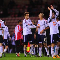 SUNDERLAND, ENGLAND - JANUARY 15: Bolton player Marcos Alonso (l) congratulates Darren Pratley after the FA Cup Third Round Replay between Sunderland and Bolton Wanderers at Stadium of Light on January 15, 2013 in Sunderland, England. (Photo by Stu Forste