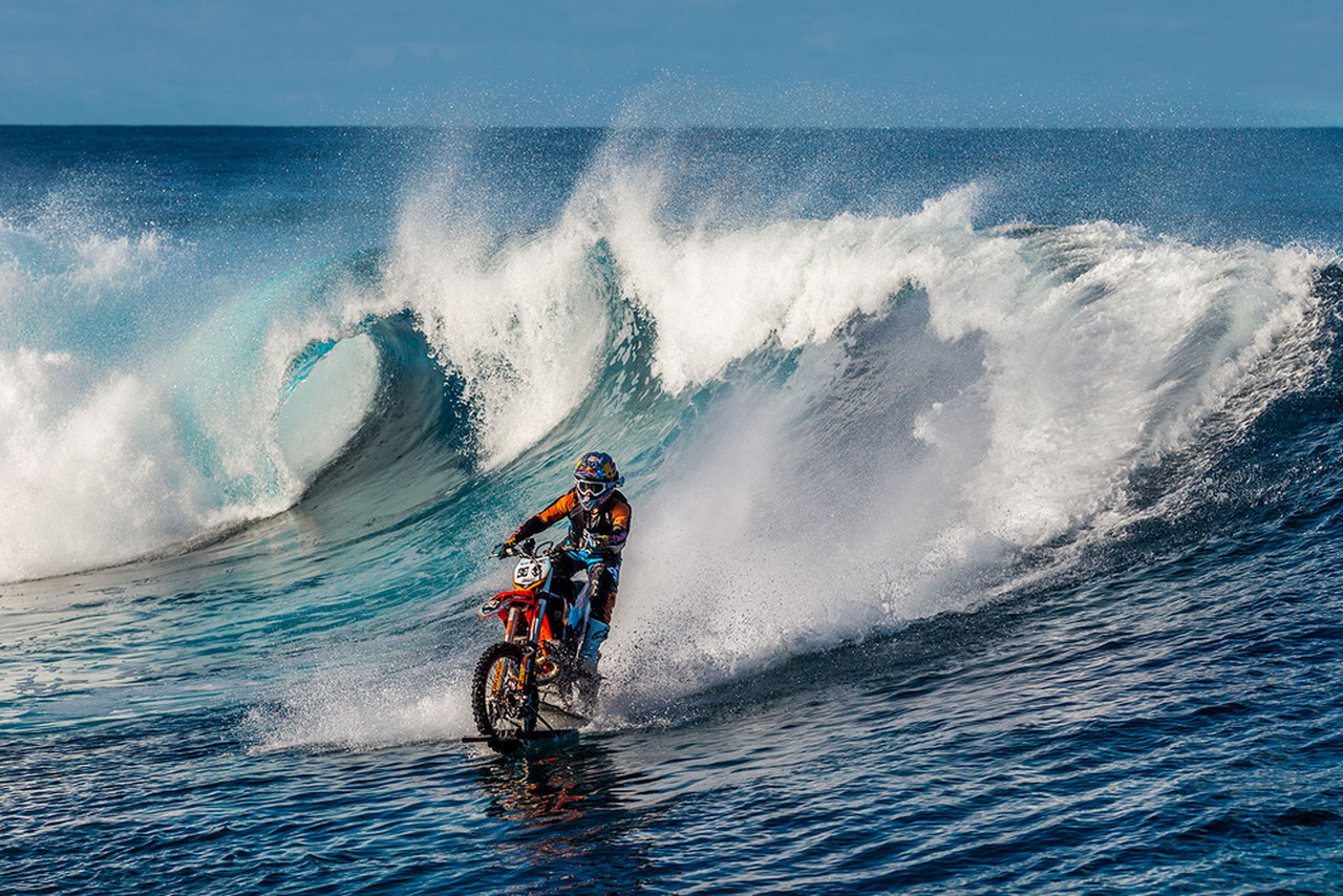 Surfing On A Dirt Bike Because Everything Else Is Too Easy The