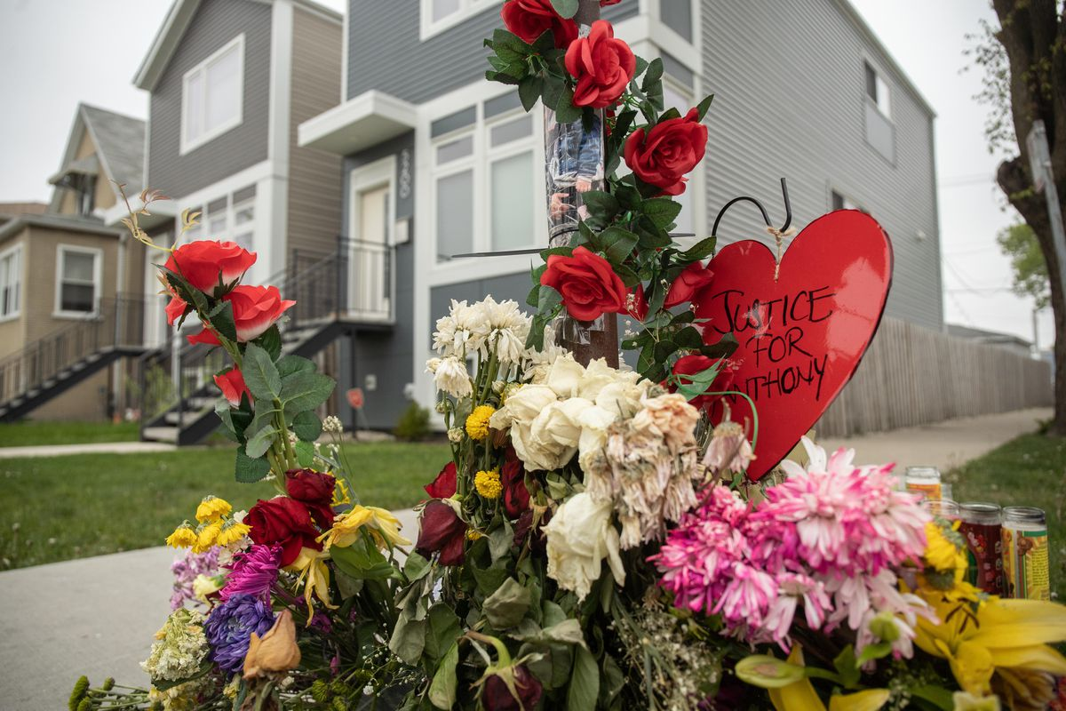 A memorial for Anthony Alvarez is set up at North Laramie Avenue and West Eddy Street in the Portage Park neighborhood, near the spot where Alvarez was fatally shot by a Chicago police officer.