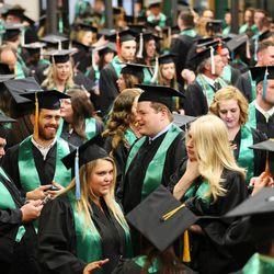 Utah Valley University graduates line up for commencement in Orem on Thursday, April 30, 2015.