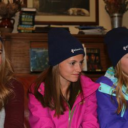 Libby Anderson, 11, left, Madi Frischknecht, 14, center, and Avery Frischknecht, 11, sport #HandsForCosmus hats at a committee meeting on Wednesday Dec. 16, 2015. The committee, made up of residents of Mapleton, is trying to raise nearly $30,000 for a Ugandan man named Opedmoth Cosmas to get prosthetic hands. Cosmas' hands were amputated after they were caught in a grinding machine in January.
