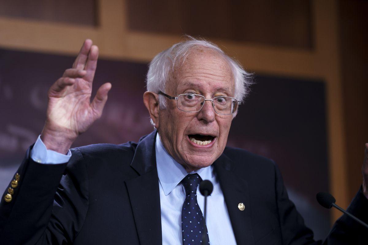 Sen. Bernie Sanders, I-Vt., talks to reporters.