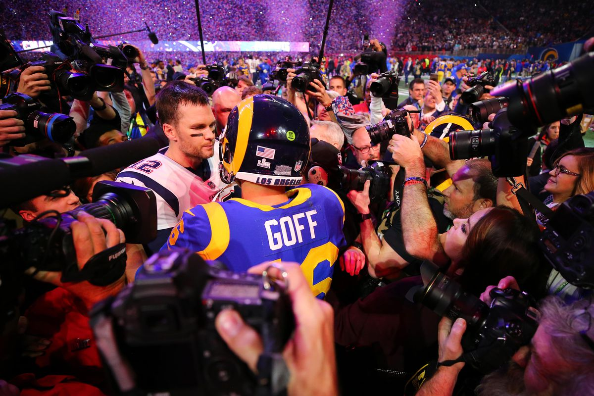 New England Patriots QB Tom Brady speaks with Los Angeles Rams QB Jared Goff after Super Bowl LIII, Feb. 3, 2019.