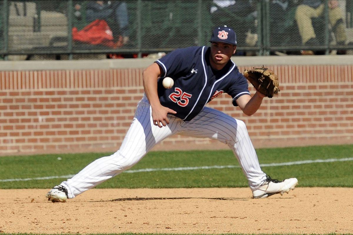 > > Auburn's Damek Tomscha fields a ground ball at third in the fourth inning vs Vanderbilt on Saturday, March 16 in Auburn.