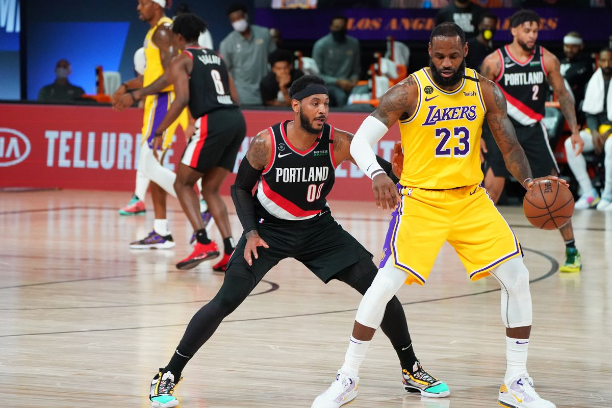 Carmelo Anthony of the Portland Trail Blazers plays defense against LeBron James of the Los Angeles Lakers during Round One, Game Five of the NBA Playoffs on August 29, 2020 at the AdventHealth Arena at ESPN Wide World Of Sports Complex in Orlando, Florida.