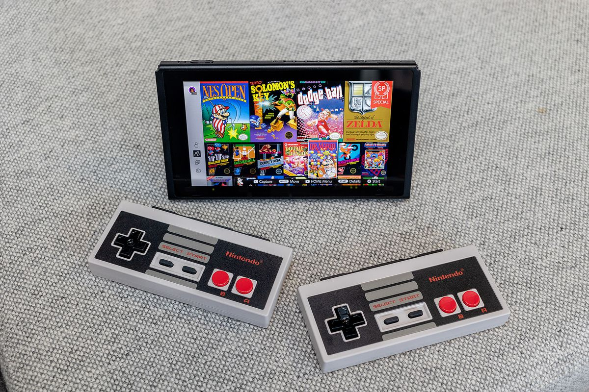 Two NES controls in front of Switch Tablet