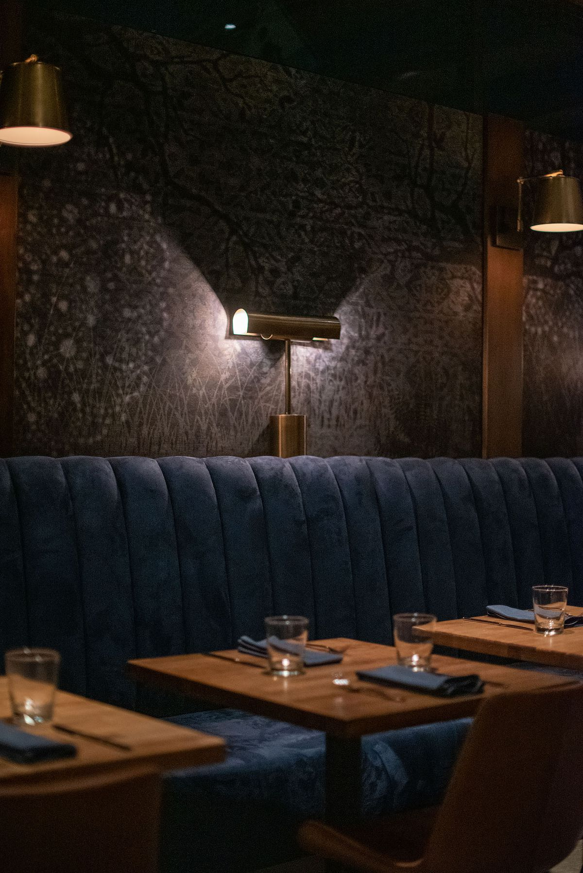 Pendant lighting at a restaurant glows from two ends.