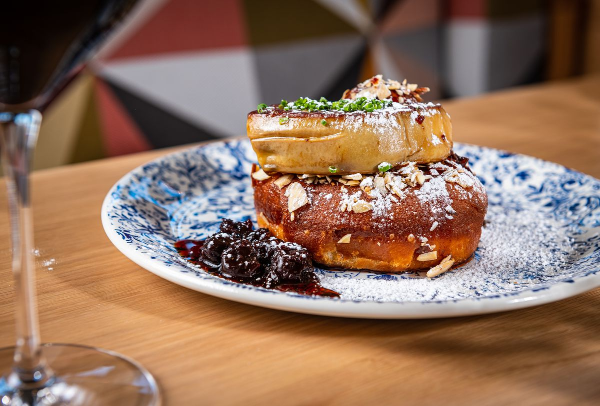 Appetizers at Ada's include a doughnut topped with a hunk of foie gras and served with cherry compote