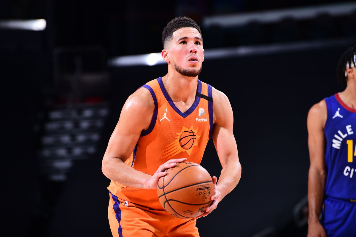 Devin Booker of the Phoenix Suns shoots a free throw during the game against the Denver Nuggets on January 22, 2021 at Talking Stick Resort Arena in Phoenix, Arizona.