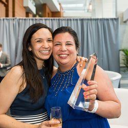 Marjorie Meek-Bradley, right, with her Rammy Award.