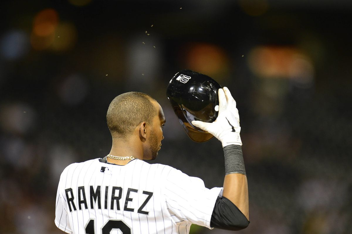 May 03, 2012; Chicago, IL, USA; Chicago White Sox shortstop Alexei Ramirez (10) swats away bugs while on first base against the Cleveland Indians in the seventh inning at US Cellular Field.  Mandatory Credit: Mike DiNovo-US PRESSWIRE
