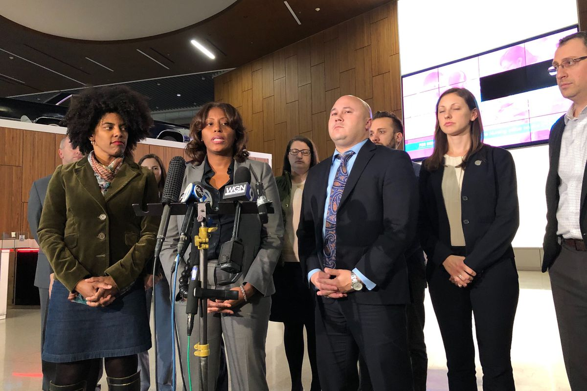 Chicago's Deputy Mayor Sybil Madison, left, Chicago Public Schools Chief Education Officer LaTanya McDade, and the school district's Chief Operating Officer Arnie Rivera, joined by members of the Chicago Public Schools bargaining team, talked with reporters after negotiations at 2:30  a.m. Oct 29, 2019, about progress in contract bargaining.